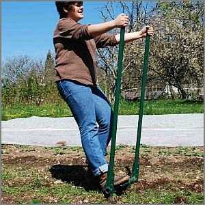 Woman pulling handles of garden broadfork
