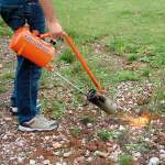 Flame weeding with a propane torch