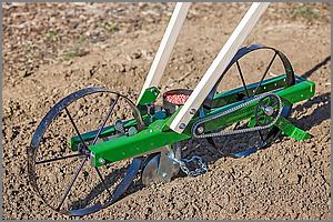 Hoss seeder in garden soil