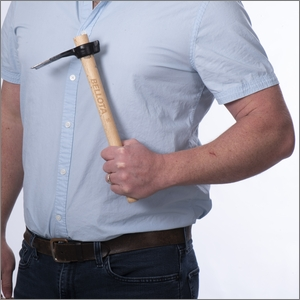 hand hoe held against a chest