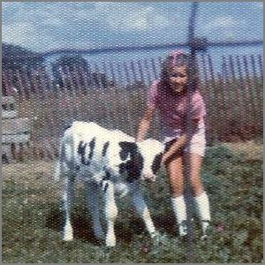 author Julie Baka with calf