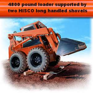 skidsteer loader supported by two shovels