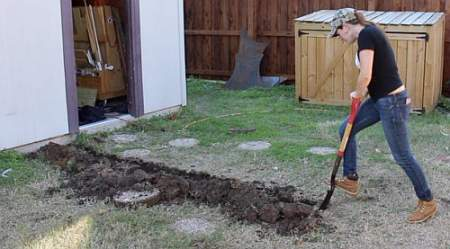 using a Sharp Shooter shovel to dig a long trench