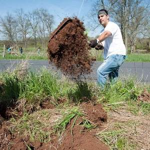 throwing soil with a shovel