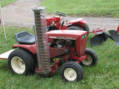 Sickle mower mounted to Wheel Horse tractor